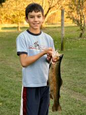 Julian with 2006's record 21 inch Rainbow.